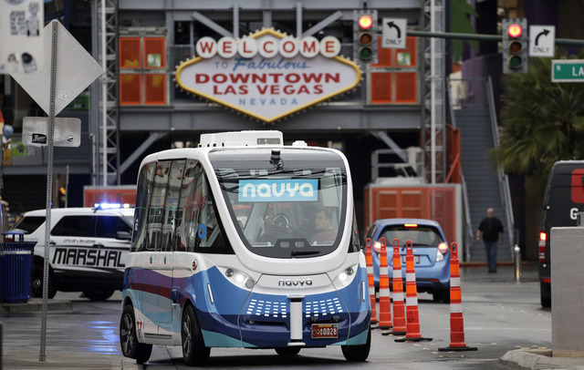In this Jan. 12, 2017, photo, the Navya Arma autonomous vehicle drives down a street  in Las Vegas. The driverless electric shuttle has begun carrying passengers in a test program in a downtown La ...