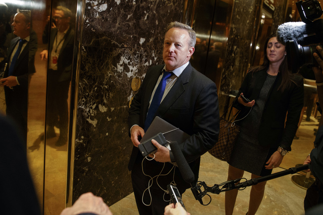 In this Nov. 14, 2016 file photo, Sean Spicer arrives at Trump Tower in New York. The Obama administration is aware of frequent contacts between President-elect Donald Trump's top national secur ...