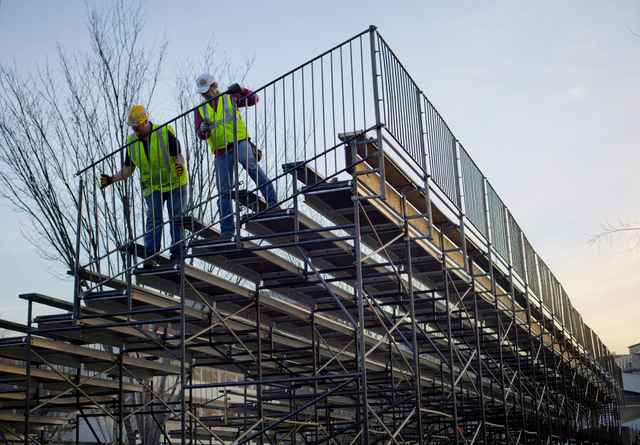 Workers install handrails for the bench seating along Pennsylvania Ave. in front of the White House in Washington, Friday, Jan. 13, 2017, as preparations continue for next week's Inauguration of P ...