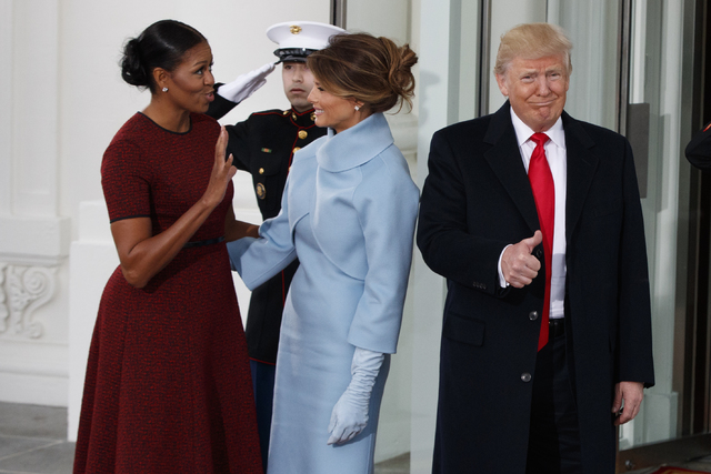 President Elect Donald Trump Gives A Thumbs Up As First Lady Michelle And