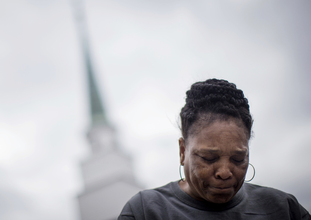Aretha Allen, who lost her niece and her niece's brother in a tornado that hit Sunshine Acres mobile home park in Adel, Ga., on Sunday, reacts Monday, Jan. 23, 2017 during an interview outside Fir ...