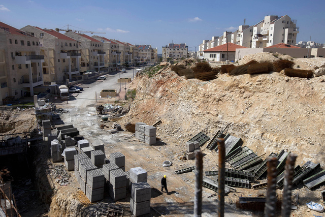 This March 14, 2011, file photo, shows a general view of a construction site in the West Bank Jewish settlement of Modiin Illit. B'tselem. Israel says it has approved 2,500 homes in West Bank sett ...