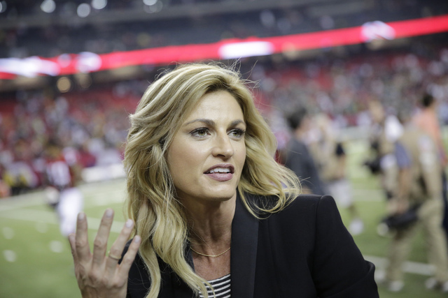 In this Oct. 30, 2016, file photo, Fox Sports broadcaster Erin Andrews, left, speaks with Atlanta Falcons wide receiver Julio Jones after the second of an NFL football game against the Green Bay P ...