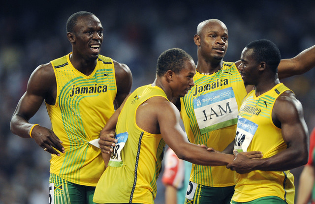 Jamaica's gold medal winning relay team, from left, Usain Bolt, Michael Frater, Asafa Powell and Nesta Carter, celebrate after the men's 4x100-meter relay final during the athletics competitions i ...
