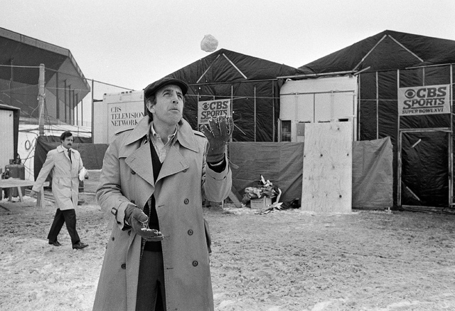 CBS Sportscaster Brent Musburger plays with a snowball outside the Silverdome in Pontiac, Mich., where the XVI Super Bowl will be played, Jan. 20, 1982. (AP)
