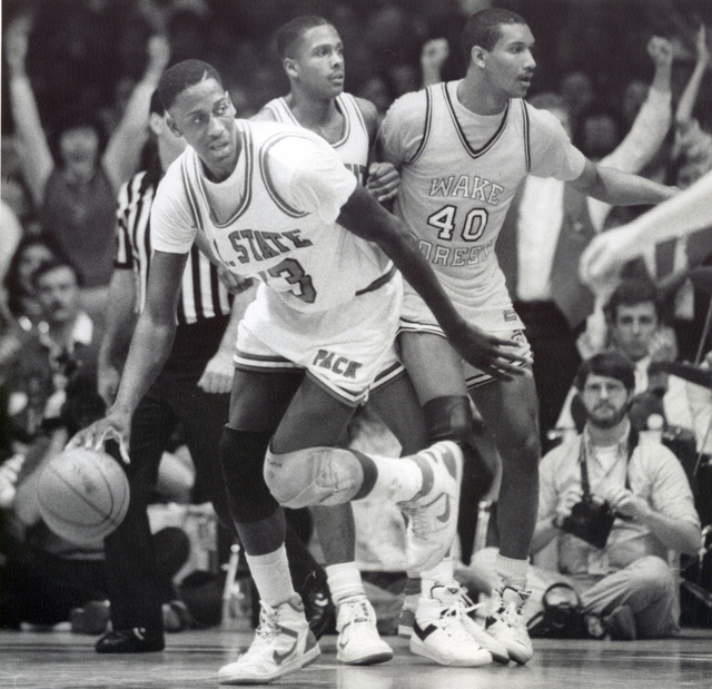 In this March 6, 1988, photo, North Carolina State NCAA college basketball player Charles Shackleford, left, plays against Wake Forest during a game in Raleigh, N.C. Shackleford, a North Carolina  ...
