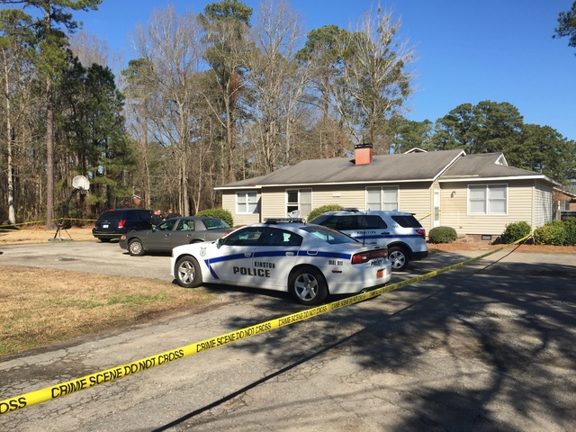 Kinston Police Department cars are parked outside a home Friday morning Jan. 27, 2017, in Kinston, N.C. Police in North Carolina say former North Carolina State basketball star Charles Shackleford ...