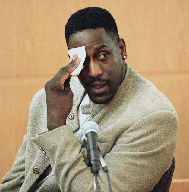 In this Dec. 4, 2000, file photo, former North Carolina State basketball star Charles Shackleford wipes his forehead as he answers questions during Rae Carruth's murder trial in Charlotte, N.C. Po ...