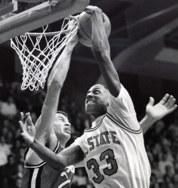 In this March 4, 1988, photo, North Carolina State NCAA college basketball player Charles Shackleford (33) battles against a Maryland player in Raleigh, N.C. Shackleford, a North Carolina State ba ...
