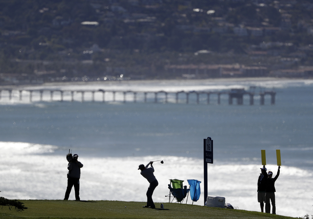 Tiger Woods hits his tee shot on the 16th hole of the north course during the second round of the Farmers Insurance Open golf tournament Friday, Jan. 27, 2017, at Torrey Pines Golf Course in San D ...