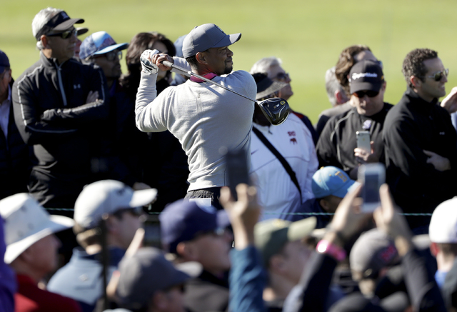 Tiger Woods watches his tee shot on the 13th hole of the north course during the second round of the Farmers Insurance Open golf tournament Friday, Jan. 27, 2017, at Torrey Pines Golf Course in Sa ...