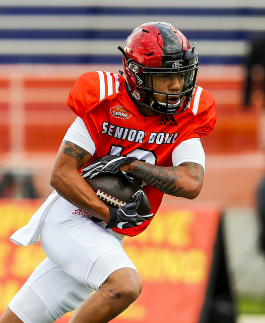 San Diego State running back Donnel Pumphrey (19) carries the ball during practice for Saturday's Senior Bowl NCAA college football game, Thursday, Jan. 26, 2017, in Mobile, Ala. (AP Photo/Butch Dill)
