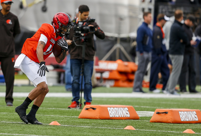 San Diego State running back Donnel Pumphrey (19) runs through drills during practice for Saturday's Senior Bowl college football game, Thursday, Jan. 26, 2017, in Mobile, Ala. (AP Photo/Butch Dill)