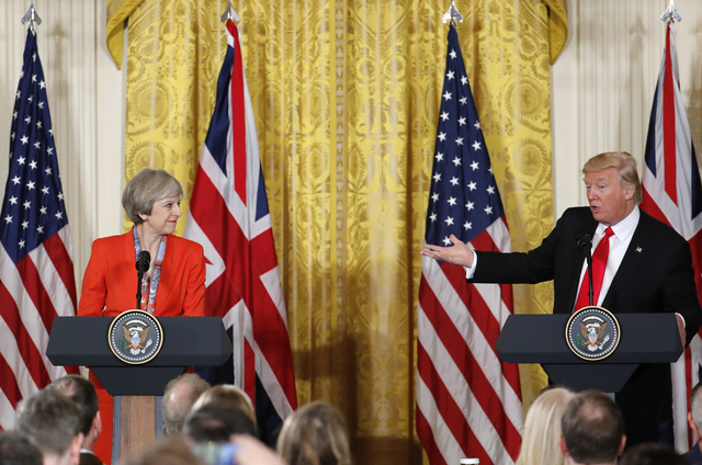 President Donald Trump and British Prime Minister Theresa May participate in a news conference in the East Room of the White House in Washington, Friday, Jan. 27, 2017.  (Pablo Martinez Monsivais/AP)