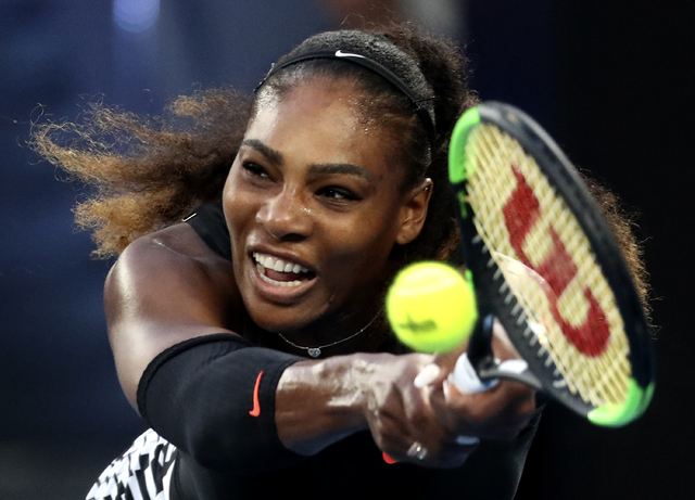 United States' Serena Williams makes a backhand return to her sister Venus during the women's singles final at the Australian Open tennis championships in Melbourne, Australia, Saturday, Jan. 28,  ...