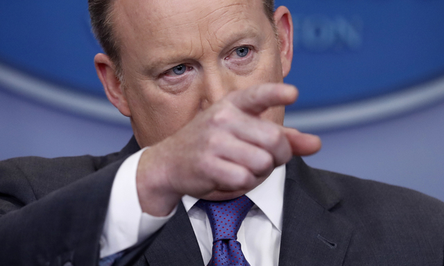 White House press secretary Sean Spicer points to a reporter to take a question during the daily news briefing at the White House in Washington, Monday, Jan. 30, 2017. Spicer discussed the weekend ...