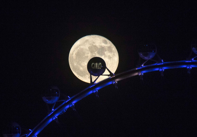 Passengers riding the 550-foot tall High Roller observation wheel are silhouetted by the rising super moon in Las Vegas, Monday, Nov. 14, 2016. Richard Brian/Las Vegas Review-Journal
