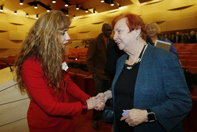 Clark County Medical Society President Souzan El-Eid shakes hands with Barbara Atkinson, founding dean of UNLV School of Medicine, after a town hall meeting to discuss an overview of the Las Vegas ...