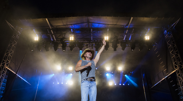 """Kenny Chesney performs during the last day of the American Country Music's """"Party for a Cause,"""" event at the Las Vegas Festival Grounds on Sunday, April 3, 2016 in Las Vegas. Ben ..."""