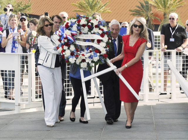 From left, Sheryl Chaffee, daughter of Roger Chaffee; Thad Altman, president of the Astronauts Memorial Foundation; Lowell Grissom, brother of Virgil Grissom; and Bonnie Baer, daughter of Ed White ...