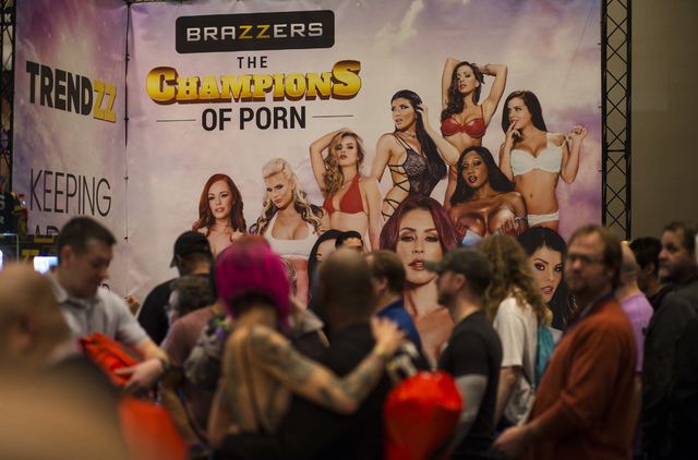 A Brazzers advertisement above the crowd during the AVN Adult Entertainment Expo at Hard Rock hotel-casino in Las Vegas on Thursday, Jan. 19, 2017. (Chase Stevens/Las Vegas Review-Journal) @csstev ...
