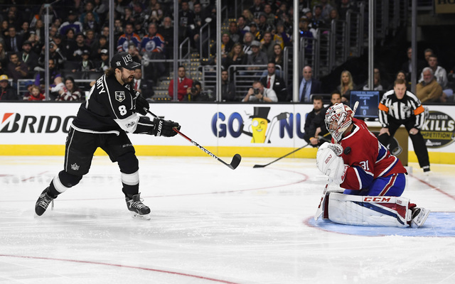Los Angeles Kings Drew Doughty, left, tries but fails to score against Montreal Canadiens' goalie Carey Price during the shootout portion of the NHL All-Star Skills Competition, Saturday, Jan. 28, ...