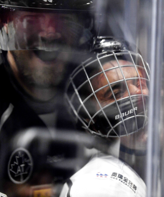 Singer Justin Bieber, who is playing for Team Gretzky, is pushed into the glass by Chris Pronger of Team Lemieux during the first period of the NHL All-Star Celebrity Shootout at Staples Center, S ...