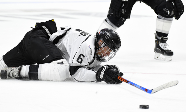 Singer Justin Bieber takes a fall during the first period of the NHL All-Star Celebrity Shootout at Staples Center, Saturday, Jan. 28, 2017, in Los Angeles. The NHL All-Star Game is scheduled to b ...