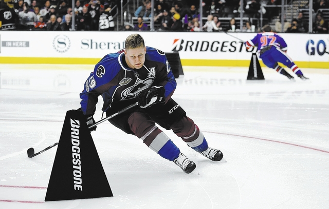 Colorado Avalanche's Nathan MacKinnon, left, skates against Edmonton Oilers' Connor McDavid during the Fastest Skater portion of the NHL All-Star Skills Competition Saturday, Jan. 28, 2017, in Los ...