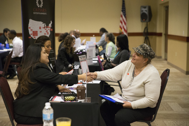 Job applicant Alma Rubalcava, right, is interviewed by Caesars Palacehotel-casino hiring representatives during a Workforce Connections hiring event at the Culinary Academy of Las Vegas on Thursda ...