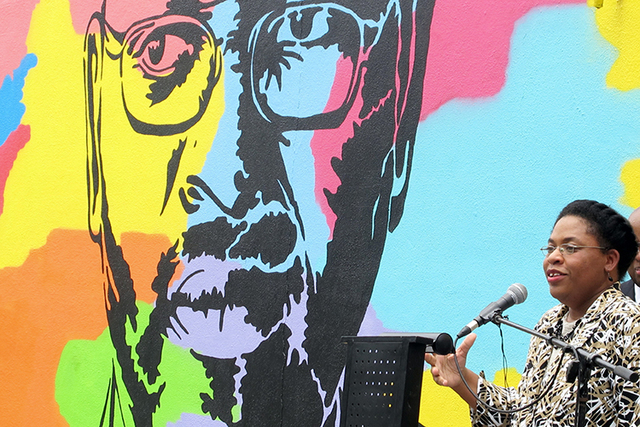 Jennifer Pinckney speaks beside an image of her late husband, the Rev. Clementa Pinckney, one of the victims of the shooting at Charleston's Emanuel AME Church, during the unveiling of the mural o ...