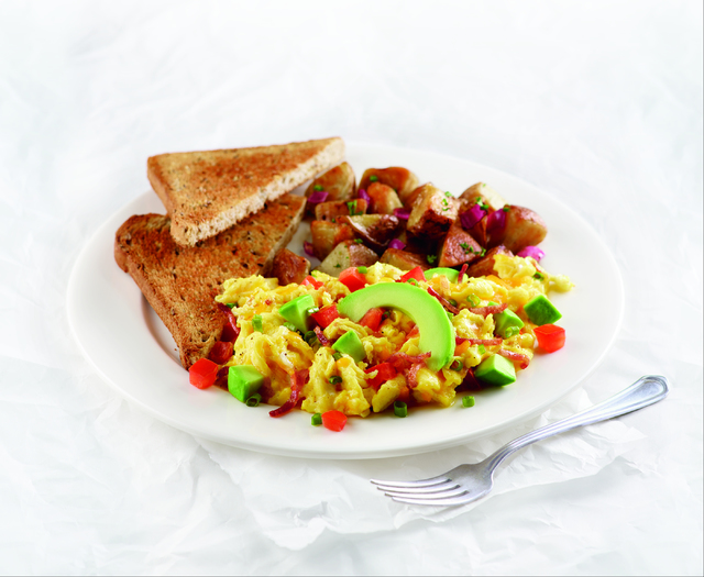 Three scrambled eggs with smoked bacon, tomatoes, green onions, cheddar cheese and avocado make up Corner Bakery Cafe's Anaheim Scrambler menu item. The restaurant chain is closer to opening its f ...