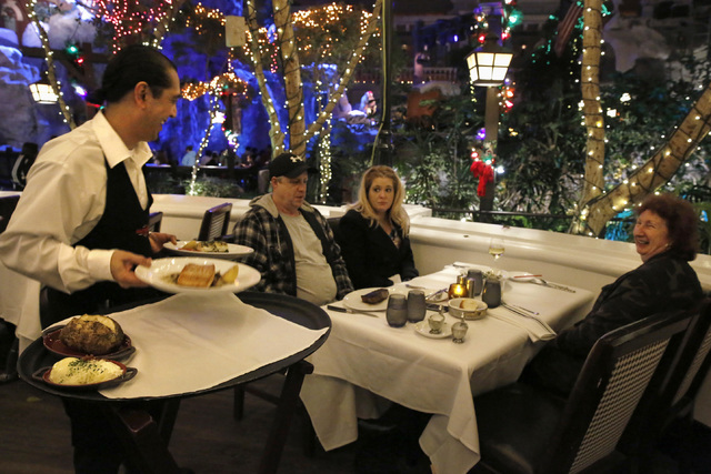 Waiter Michael Milande serves guests at The Angry Butcher Steakhouse at Sam's Town hotel-casino, Friday, Dec. 23, 2016 in Las Vegas. (David Guzman/Las Vegas Review-Journal) @DavidGuzman1985