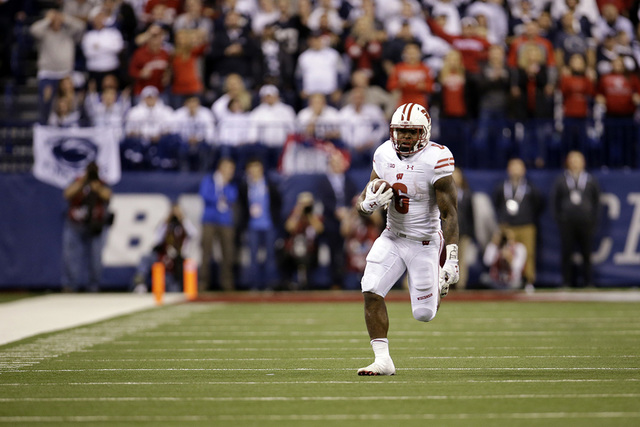 Wisconsin running back Corey Clement runs with the ball during the second half of the Big Ten championship NCAA college football game against Penn State, Saturday, Dec. 3, 2016, in Indianapolis. ( ...