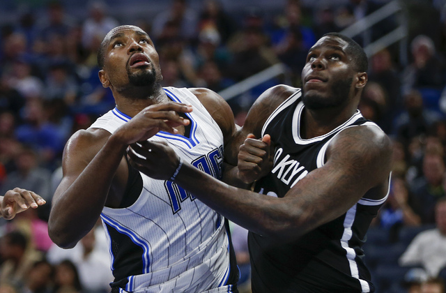Orlando Magic forward Serge Ibaka,left, and Brooklyn Nets forward Anthony Bennett (13) battle for the rebound during an NBA basketball game in Orlando, Fla., on Friday, Dec. 16, 2016. The Orlando  ...
