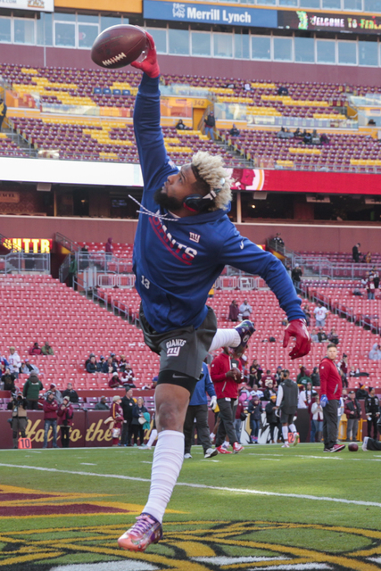 New York Giants wide receiver Odell Beckham (13) warms up before an NFL football game against the Washington Redskins in Landover, Md., Sunday, Jan. 1, 2017. (Mark Tenally/AP)
