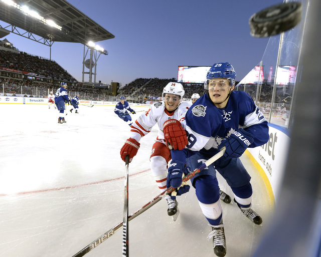 Toronto Maple Leafs center William Nylander (29) and Detroit Red Wings right wing Gustav Nyquist (14) chase the puck along the corner boards during second-period NHL Centennial Classic hockey game ...