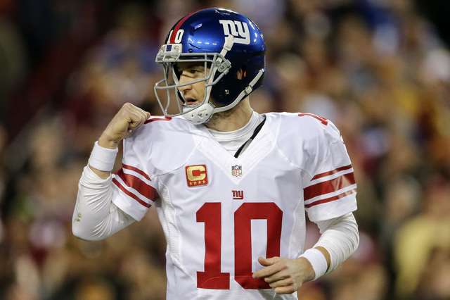 New York Giants quarterback Eli Manning celebrates running back Rashad Jennings' touchdown during the first half of a game against the Washington Redskins in Landover, Md., Sunday, Jan. 1, 2017. ( ...