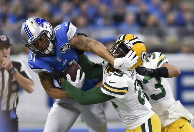 Detroit Lions wide receiver Marvin Jones is pushed out of bounds by Green Bay Packers cornerback Damarious Randall (23) during the first half  Sunday, Jan. 1, 2017, in Detroit. (AP Photo/Jose Juarez)