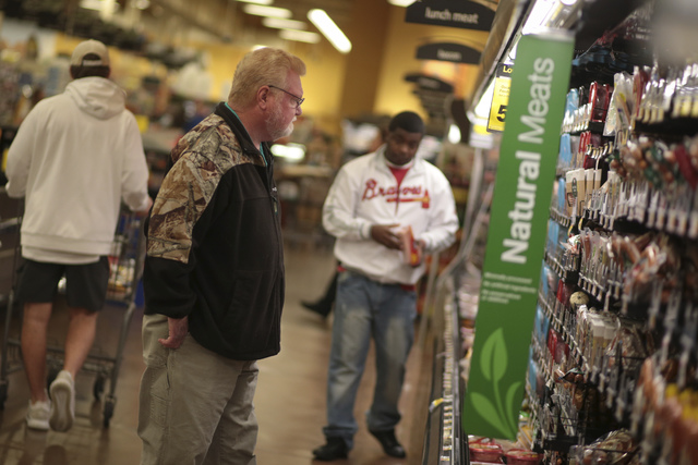 Danny Morgan, left, shops at Kroger located off of Alps Road in Athens, Georgia, Thursday, Jan. 5, 2017. Forecasters are calling for 1-3 inches of snow throughout the weekend in the area.  (John R ...