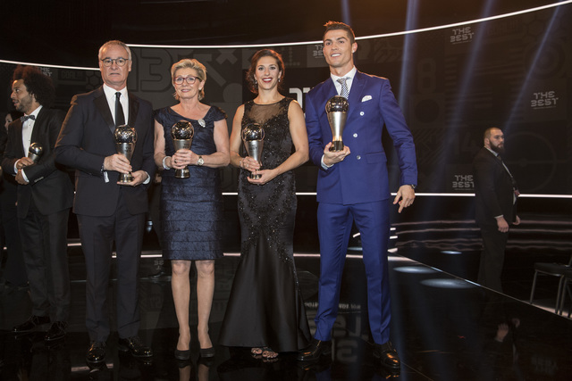 Claudio Ranieri of Italy, coach of Leicester City FC, former German women's national soccer team head coach Silvia Neid, United States' Carli Lloyd and Real Madrid's Cristiano Ronaldo, from left,  ...