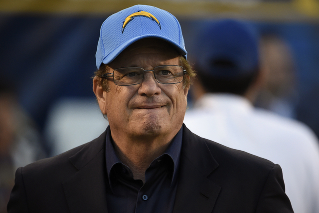 In this Dec. 18, 2016, file photo, San Diego Chargers team president and CEO Dean Spanos looks on during the second half of an NFL football game against the Oakland Raiders, in San Diego. (Denis P ...