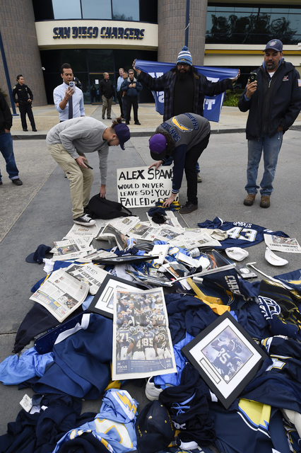 Former Chargers fans dump memorabilia in front of Chargers headquarters after the team announced that it will move to Los Angeles, Thursday Jan. 12, 2017, in San Diego. (Denis Poroy/AP)
