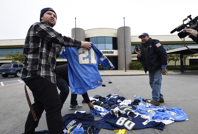 Former San Diego Chargers fans throw down Chargers jerseys in front of Chargers headquarters after the NFL football team announced that it will move to Los Angeles, Thursday Jan. 12, 2017, in San  ...