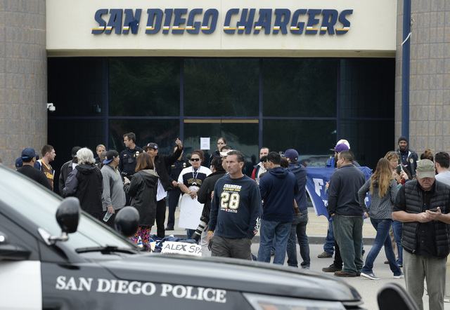 Fans gather in front of San Diego Chargers headquarters after the team announced that it will move to Los Angeles Thursday Jan. 12, 2017, in San Diego. (Denis Poroy/AP)