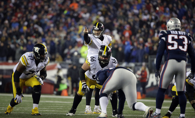 Pittsburgh Steelers quarterback Ben Roethlisberger (7) calls a play at the line of scrimmage during the first half of the AFC championship NFL football game against the New England Patriots, Sunda ...