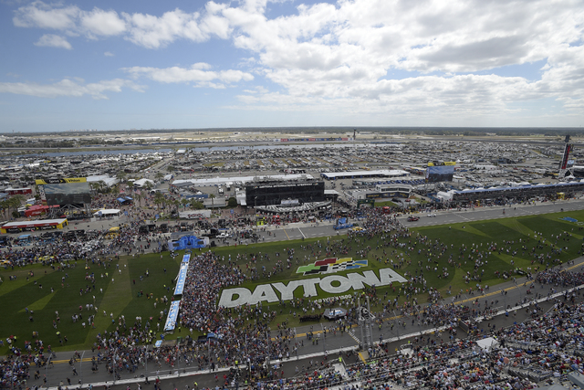 This Feb. 21, 2016 file photo shows fans gathering on the grass in front of the grandstands of Daytona International Speedway before the NASCAR Daytona 500 Sprint Cup series auto race in Daytona B ...