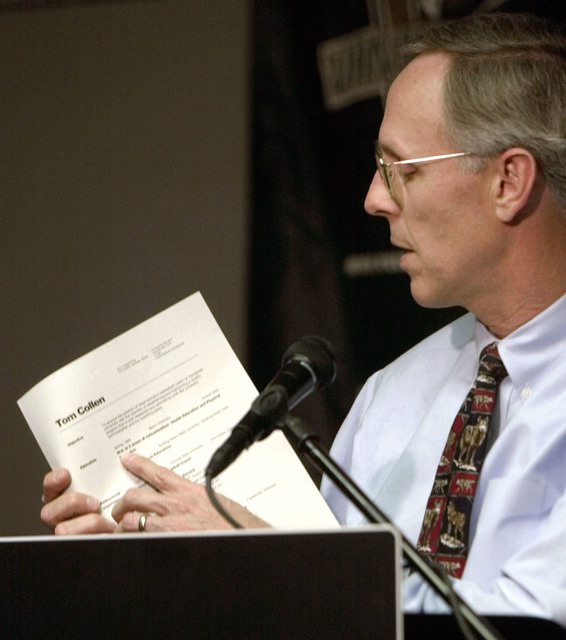 Vanderbilt athletic director Todd Turner displays the resume of Colorado State women's basketball coach Tom Collen on Thursday, May 2, 2002, in Nashville, Tenn. (Mark Humphrey/AP)