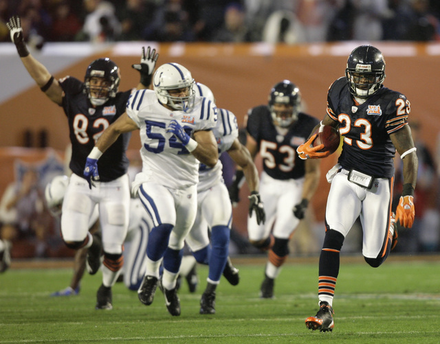 Chicago Bears' Devin Hester (23) runs back the opening kickoff 92-yards for a touchdown in the Super Bowl XLI football game against the Indianapolis Colts at Dolphin Stadium in Miami on Sunday, Fe ...