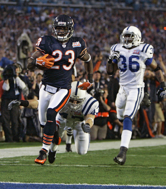 **FILE** In this Feb. 4, 2007 file photo, Chicago Bears cornerback Devin Hester (23) scores a touchdown on a kickoff return past Indianapolis Colts' Matt Giordano (43) and Dexter Reid (36) during  ...